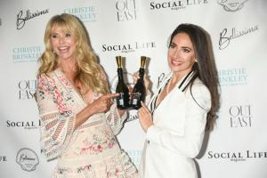 Supermodel Christie Brinkley & Super Entrepreneur Carissa Kranz Point to the BevVeg Vegan Certification Trademark on Vegan Wine.